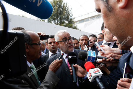 Prime Minister and leader of the Islamist Justice and Development Party, known as the PJD, Abdelilah Benkirane speaks to journallists after voting for the parliamentary elections, in Rabat, Morocco, . Millions of Moroccans hit the voting booths, with worries about joblessness and extremism on many minds as they choose which party will lead their next government