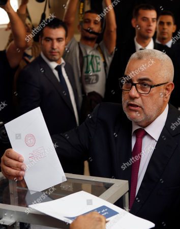 Prime Minister and leader of the Islamist Justice and Development Party, known as the PJD, Abdelilah Benkirane casts his ballot at a polling station for the parliamentary elections, in Rabat, Morocco, . Millions of Moroccans hit the voting booths, with worries about joblessness and extremism on many minds as they choose which party will lead their next government