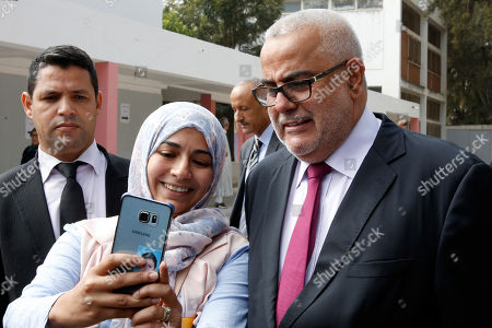Prime Minister and leader of the Islamist Justice and Development Party, known as the PJD, Abdelilah Benkirane poses for a selfie after voting for the parliamentary elections, in Rabat, Morocco, . Millions of Moroccans hit the voting booths, with worries about joblessness and extremism on many minds as they choose which party will lead their next government