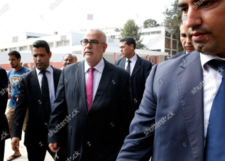 Prime Minister and leader of the Islamist Justice and Development Party, known as the PJD, Abdelilah Benkirane leaves after voting for the parliamentary elections, in Rabat, Morocco, . Millions of Moroccans hit the voting booths, with worries about joblessness and extremism on many minds as they choose which party will lead their next government