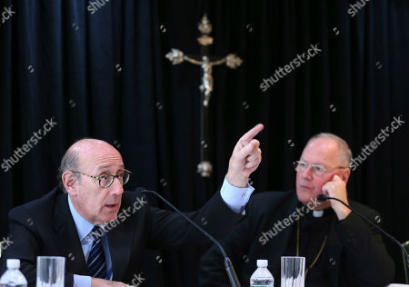 Kenneth Feinberg, Timothy Dolan Cardinal Timothy Dolan, Archbishop of New York, right, listens as Kenneth Feinberg speaks to reporters during a news conference in New York, . Dolan helped to announce a new program intended to provide reconciliation and compensation for victims of sexual abuse by clergy; Feinberg will administer the independent program