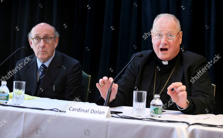 Kenneth Feinberg, Timothy Dolan Cardinal Timothy Dolan, Archbishop of New York, speaks to reporters during a news conference in New York, as Kenneth Feinberg, left, listens. Dolan helped to announce a new program intended to provide reconciliation and compensation for victims of sexual abuse by clergy; Feinberg will administer the independent program