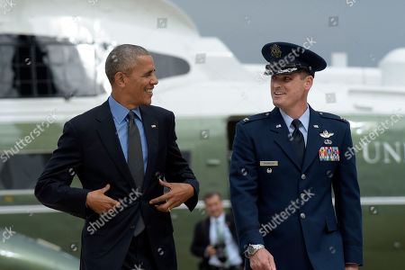 Barack Obama President Barack Obama talks with Air Force Colonel Christopher Thompson as he is about to walk up the steps of Air Force One at Andrews Air Force Base in Md.,. Obama is traveling to Chicago for the weekend