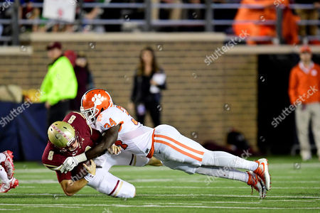Clemson Tigers linebacker Kendall Joseph (34) Boston College Eagles quarterback Patrick Towles (8) during the NCAA division 1 football game between the Clemson Tigers and the Boston College Eagles held at Alumni Stadium in Chestnut Hill, Massachusetts