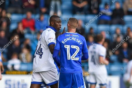 Oldham Athletic midfielder Ousmane Fane (24) and Gillingham defender Paul Konchesky (12) exchange words during the EFL Sky Bet League 1 match between Gillingham and Oldham Athletic at the MEMS Priestfield Stadium, Gillingham