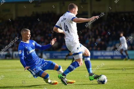 Gillingham defender Paul Konchesky (12) and Oldham Athletic defender Brian Wilson (4) during the EFL Sky Bet League 1 match between Gillingham and Oldham Athletic at the MEMS Priestfield Stadium, Gillingham