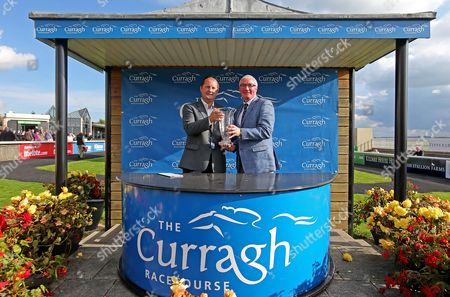 Fran Walsh, Circulation Editor of The Irish times presents the trophy to winning owner Gerard O'Leary after the third race of the day