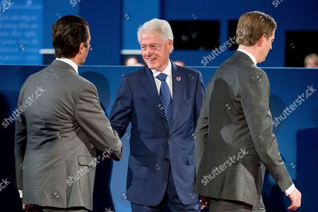 Bill Clinton, Eric Trump, Donald Trump Jr Donald Trump, Jr., left, accompanied by Eric Trump, right, the sons of Republican presidential candidate Donald Trump, shakes hands with former President Bill Clinton, husband of Democratic presidential candidate Hillary Clinton, before the second presidential debate at Washington University, in St. Louis