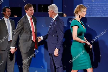 Eric Trump, Donald Trump Jr., Ivanka Trump, Bill Clinton Former president Bill Clinton, third from left, shakes hands with, from left, Donald Trump Jr., Eric Trump, and Ivanka Trump before the beginning of the second presidential debate at Washington University, in St. Louis