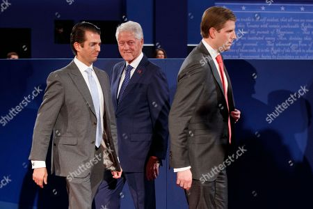 Eric Trump, Donald Trump Jr., Bill Clinton Former president Bill Clinton, center, meets with Donald Trump Jr., left, and Eric Trump before the second presidential debate at Washington University, in St. Louis