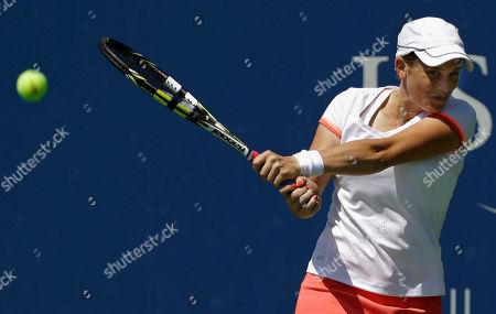 Romina Oprandi Romina Oprandi, of Swizterland, returns a shot against Daniela Hantuchova, of Slovakia, during the opening round of the 2014 U.S. Open tennis tournament, in New York