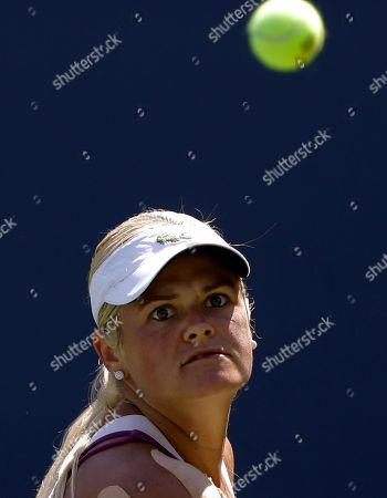 Aleksandra Wozniak Aleksandra Wozniak, of Canada, looks to return a shot against Kurumi Nara, of Japan, during the opening round of the 2014 U.S. Open tennis tournament, in New York