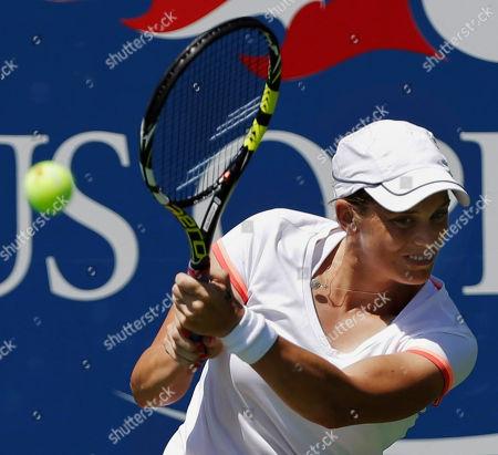Romina Oprandi Romina Oprandi, of Swizterland, returns a shot against Daniela Hantuchova, of Slovakia, of the United States, during the opening round of the 2014 U.S. Open tennis tournament, in New York