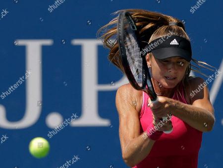 Daniela Hantuchova Daniela Hantuchova, of Slovakia, returns a shot against Romina Oprandi, of Swizterland, during the opening round of the 2014 U.S. Open tennis tournament, in New York
