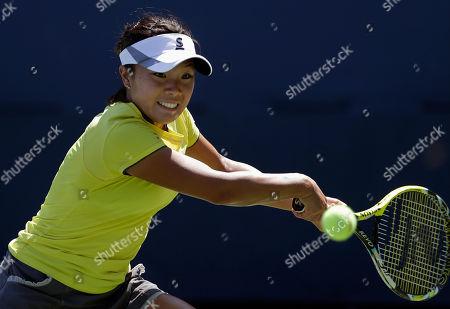Kurumi Nara Kurumi Nara, of Japan, returns a shot against Aleksandra Wozniak, of Canada, during the opening round of the 2014 U.S. Open tennis tournament, in New York