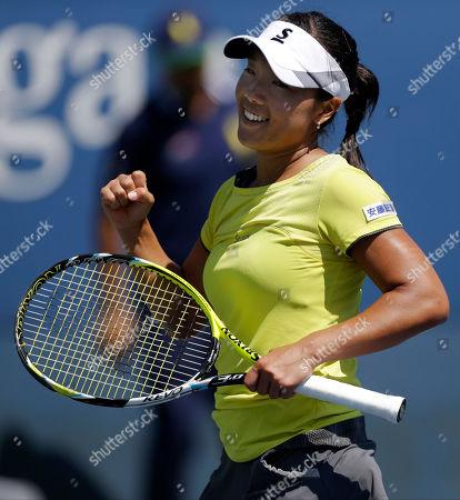 Kurumi Nara Kurumi Nara, of Japan, reacts after defeating Aleksandra Wozniak, of Canada, during the opening round of the 2014 U.S. Open tennis tournament, in New York