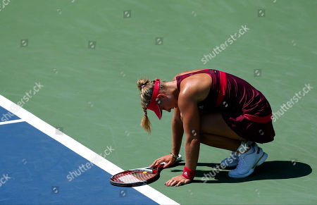 Angelique Kerber Angelique Kerber, of Germany, reacts after a shot against Ksenia Pervak, of Russia, during the opening round of the 2014 U.S. Open tennis tournament, in New York
