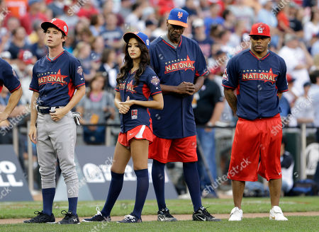 Nelly, Dwight Gooden, Charlie McDermott, Melanie Iglesias Actor Charlie McDermott, left, stands with actress Melanie Iglesias, second from left, former pitcher Dwight Gooden, and rapper Nelly, right, during the All-Star Legends & Celebrity Softball Game, in Minneapolis