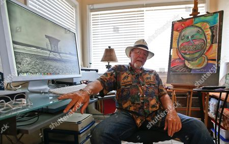 Michael Gross Artist Michael Gross, who is battling cancer, sits in his studio between one of his paintings and one of his photos on his computer screen in Oceanside, Calif. Gross has decided to use his art and the work of other artist to raise money in his fight against cancer