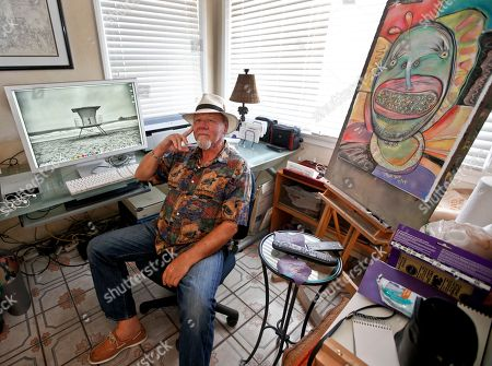 Michael Gross Artist Michael Gross, who is battling cancer, sits in his studio between one of his paintings and one of his photos on his computer screen in Oceanside, Calif. Gross has decided to use his and the work of other artists to raise money in his fight against cancer