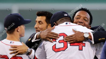 Nomar Garciaparra, Pedro Martinez Boston Red Sox great Pedro Martinez, right, embraces designated hitter David Ortiz after throwing out the ceremonial first pitch prior to a baseball game at Fenway Park in Boston, . Martinez, Nomar Garciaparra and Roger Clemens were inducted into the Boston Red Sox Hall of Fame earlier in the day