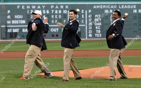 Roger Clemens, Nomar Garciaparra, Pedro Martinez Boston Red Sox greats Roger Clemens, Nomar Garciaparra and Pedro Martinez throw out the ceremonial first pitch prior to a baseball game at Fenway Park in Boston