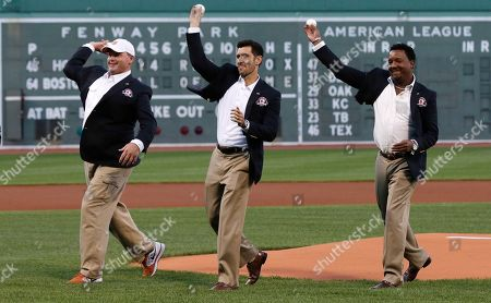 Roger Clemens, Nomar Garciaparra, Pedro Martinez Boston Red Sox greats Roger Clemens, Nomar Garciaparra and Pedro Martinez, from left, throw out the ceremonial first pitch prior to a baseball game at Fenway Park in Boston, . Clemens, Garciaparra and Martinez were inducted into the Boston Red Sox Hall of Fame earlier in the day