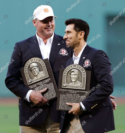 Roger Clemens, Nomar Garciaparra Boston Red Sox greats Roger Clemens, left, talks with former teammate Nomar Garciaparra while holding their plaques prior to a game at Fenway Park in Boston, . Garciaparra and Clemens were inducted into the Boston Red Sox Hall of Fame earlier in the day