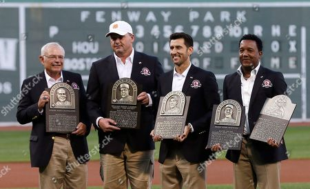 Roger Clemens, Nomar Garciaparra, Pedro Martinez, Joe Castiglione Boston Red Sox broadcaster Joe Castiglione, left, stands with team greats Roger Clemens, Nomar Garciaparra and Pedro Martinez, from left, with their plaques prior to a game at Fenway Park in Boston, . Castiglione, Clemens, Garciaparra and Martinez were inducted into the Boston Red Sox Hall of Fame earlier in the day