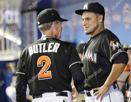 A.J. Ramos, Brett Butler Miami Marlins third base coach Brett Butler (2) talks with relief pitcher A.J. Ramos before the start of a baseball game against the Oakland Athletics, in Miami. The Athletics beat the Marlins 7-6 in 14 innings