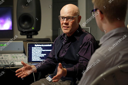 "Stock Image of Thomas Dolby In this picture, musician Thomas Dolby speaks with students in his class, ""Sound on Film,"" at Johns Hopkins University's Peabody Institute music conservatory in Baltimore. Dolby, perhaps best known for his 1980's song ""She Blinded Me With Science,"" has made several careers at the nexus of sound and electronics. His newest role began Friday as a professor of the arts at Hopkins, and he hopes to show students how new technology creates fresh opportunities for composers and filmmakers to collaborate"