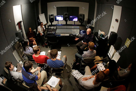 "Thomas Dolby In this picture made with a fisheye lens, musician Thomas Dolby, top right, speaks with students in his class, ""Sound on Film,"" at Johns Hopkins University's Peabody Institute music conservatory in Baltimore. Dolby, perhaps best known for his 1980's song ""She Blinded Me With Science,"" has made several careers at the nexus of sound and electronics. His newest role began Friday as a professor of the arts at Hopkins, and he hopes to show students how new technology creates fresh opportunities for composers and filmmakers to collaborate"