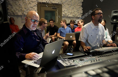 "Stock Picture of Thomas Dolby In this picture, musician Thomas Dolby, left, prepares for his class, ""Sound on Film,"" at Johns Hopkins University's Peabody Institute music conservatory in Baltimore. Dolby, perhaps best known for his 1980's song ""She Blinded Me With Science,"" has made several careers at the nexus of sound and electronics. His newest role began Friday as a professor of the arts at Hopkins, and he hopes to show students how new technology creates fresh opportunities for composers and filmmakers to collaborate"