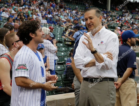 Tom Ricketts, Thomas Ian Nicholas Chicago Cubs Chairman Tom Ricketts, right, talks with Thomas Ian Nicholas before a baseball between the Atlanta Braves and the Chicago Cubs in Chicago