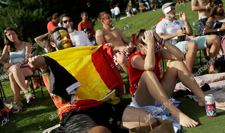 Tom Van Schingen, Lynsi Lewis Tom Van Schingen, left, of Belgium, celebrates as his girlfriend Lynsi Lewis, right, of Atlanta, hangs her head after Belgium scored their second goal against the United States in a 2014 World Cup soccer match at a public viewing party in Piedmont Park, in Atlanta
