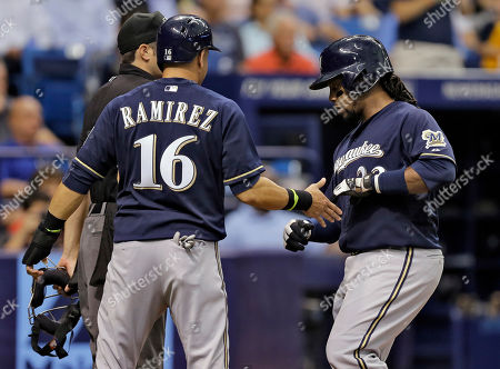 Milwaukee Brewers' Aramis Ramirez (16) and Rickie Weeks celebrate after scoring on a two-run single by Martin Maldonado off Tampa Bay Rays starting pitcher David Price during the second inning of an interleague baseball game, in St. Petersburg, Fla