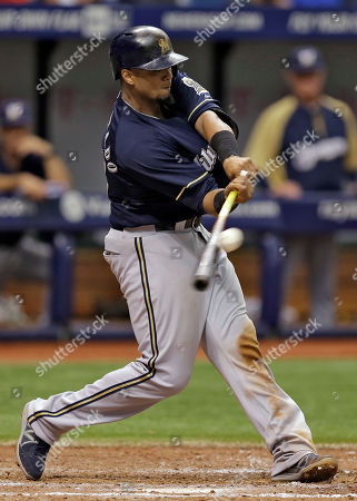 Milwaukee Brewers' Martin Maldonado hits an RBI double off Tampa Bay Rays starting pitcher David Price during the seventh inning of an interleague baseball game, in St. Petersburg, Fla. Brewers Mark Reynolds scored on the play