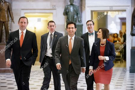 Eric Cantor Majority Leader Eric Cantor, R-Va., is surrounded by his staff as he walks to the House chamber for votes, at the Capitol in Washington, . As a result of his stunning primary defeat in the Virginia primary in June, Cantor will relinquish his leadership post tomorrow as Congress leaves for a five week recess