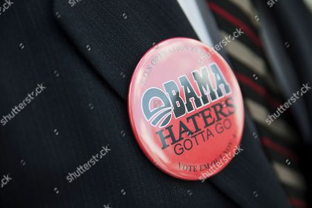 Jeffery Jones wears a button during a march at the Alabama State Capitol and Statehouse, in Montgomery, Ala. The marches in Montgomery are part of the Moral Week of Action, which is going on in North Carolina, Mississippi, Georgia, South Carolina, Florida and Virginia, state Sen. Hank Sanders of Selma said