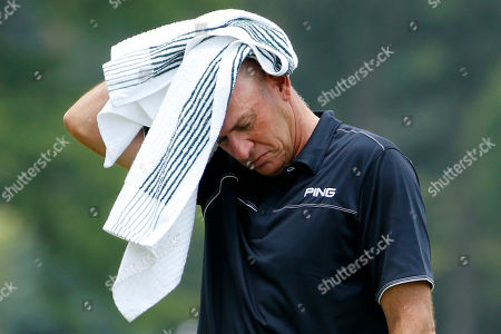 Peter Fowler Peter Fowler of Sydney, Australia wipes his head while waiting to putt on the 18th green during the second round of the Senior Players Championship golf tournament at Fox Chapel Golf Club in Pittsburgh