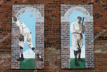 "This photo shows paintings of Leroy Robert ""Satchel"" Paige, left, and Babe Ruth at League Park in Cleveland. The city of Cleveland has invested $6.3 million in restoring the old site of League Park, a historic site where the Cleveland Indians clinched its 1920 World Series title, Babe Ruth hit his 500th home run and where Joe DiMaggio extended his hitting streak to 56 games"