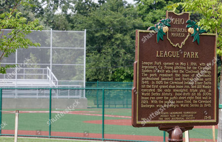 League Park This photo shows an Ohio Historical Marker plaque commemorating League Park resting near the field in Cleveland. The city of Cleveland has invested $6.3 million in restoring the old site of League Park, a historic site where the Cleveland Indians clinched its 1920 World Series title, Babe Ruth hit his 500th home run and where Joe DiMaggio extended his hitting streak to 56 games. Not much of the old ballbark, where Cy Young threw the first pitch in 1891 remains, but the new park will host high school and youth games on its all-turf field and will pay homage to the greats who once played there