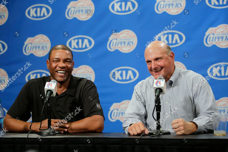 Steve Ballmer, Doc Rivers New Los Angeles Clippers owner Steve Ballmer, right, and head coach Doc Rivers share a laughter during a news conference held after the Clippers Fan Festival in Los Angeles. Rivers is staying with the Los Angeles Clippers for another five years. In Ballmer's first big move since taking over as the team's new owner last week, he has locked in Rivers through the 2019 season. Ballmer said, it was one of his top priorities to ensure that Rivers remains as the long-term leader of the team