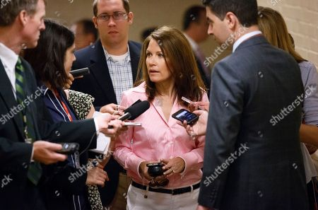 Michele Bachmann Rep. Michele Bachmann, R-Minn., center, is surrounded by reporters on Capitol Hil in Washington, as she leaves a closed-door meeting of House Republicans on the border crisis. House Republicans pushed legislation on Friday that could clear the way for eventual deportation of more than 500,000 immigrants brought here illegally as kids and address the surge of immigrants at the U.S.-Mexico border