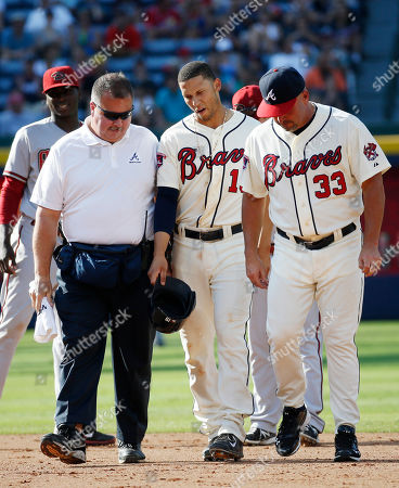 Andrelton SImmons, Jim Lovell, Fredi gonzalez Atlanta Braves shortstop Andrelton Simmons, center, walks off the field with assistant athletic trainer Jim Lovell and manager Fredi Gonzalez (33) after being injured in the sixth inning of a baseball game against the Arizona Diamondbacks in Atlanta