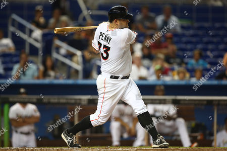 Brad Penny Miami Marlins' Brad Penny hits a double during the third inning of a baseball game in Miami against the Arizona Diamondbacks