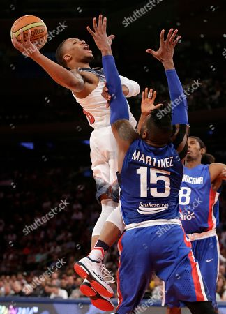 Jack Michael Martinez, Edward Santana, Damian Lillard Dominican Republic center Jack Michael Martinez (15) and forward Edward Santana (8) defend U.S. guard Damian Lillard during the first half of an exhibition basketball game at Madison Square Garden in New York