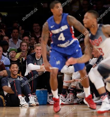 Derrick Rose, Mason Plumlee U.S. guard Derrick Rose, lower left, and forward Mason Plumlee, next to Rose, watch the second half of an exhibition basketball game between the United States and the Dominican Republic at Madison Square Garden in New York, . The U.S. team won 105-62