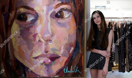 """Stock Picture of Isabella Rose Taylor Isabella Rose Taylor, 13, poses with her art work and clothing designs at her home, in Austin, Texas. Her fashion line is debuting at Nordstrom stores and she's set to hold her first show at New York Fashion Week. Taylor said she created a fall line with a """"street grunge vibe"""" and """"modern hippie"""" inspiration"""