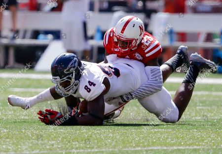 Daniel Davie, Alex Deleon Florida Atlantic tight end Alex Deleon (84) is tackled by Nebraska cornerback Daniel Davie (23) in the first half of an NCAA college football game in Lincoln, Neb